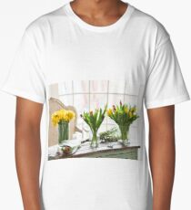 Spring flowers on a wooden table Long T-Shirt