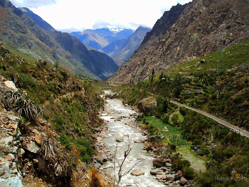 River flowing through a valley in the Andes by Honor Kyne