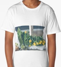 Yellow tulips flowers bouquet on a wooden table Long T-Shirt
