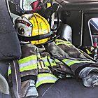 Yellow Fire Helmet In Fire Truck by Susan Savad