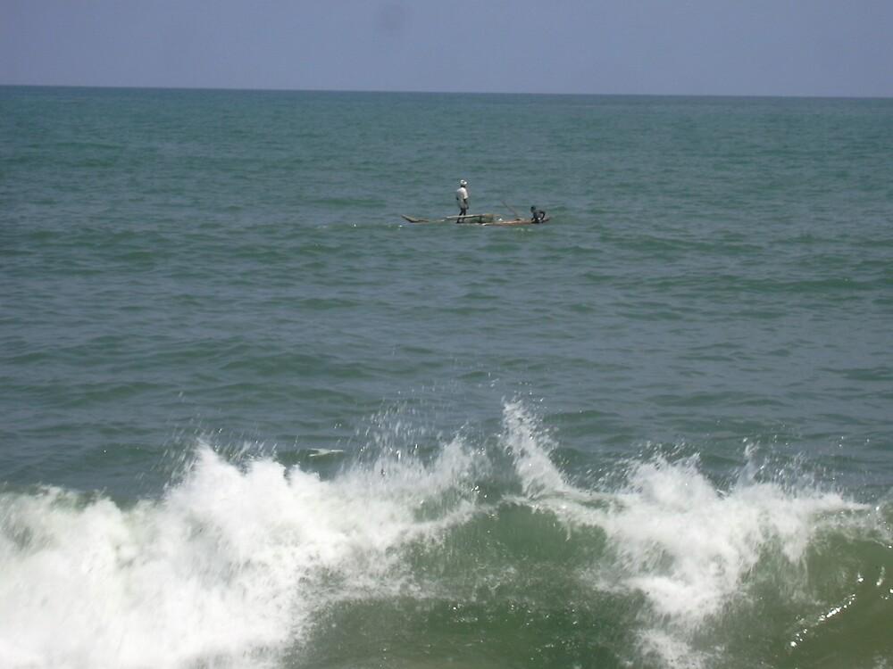 standing on sea by pugazhraj