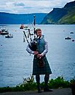 Piper @ Portree Harbour by Yukondick