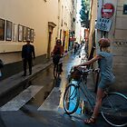 Cyclist St Germain street Paris, early morning mid summers day. by DavidMay