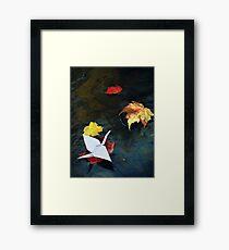 Origami paper crane on autumn leaf in a stream art photo print Framed Print