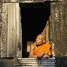 Monk in a window - Cambodia by Christophe Dur