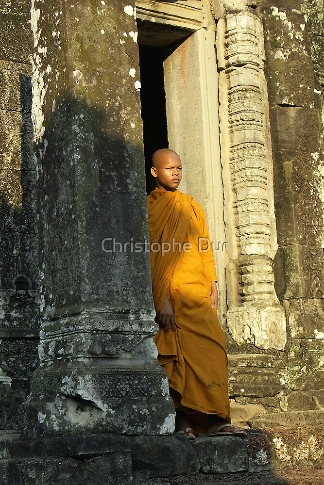 Young monk in a temple - Cambodia by Christophe Dur