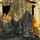 Monk in a temple - Cambodia by Christophe Dur