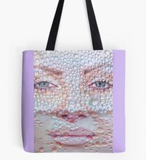 Pretty girl face against transparent water drips as background. Tote Bag