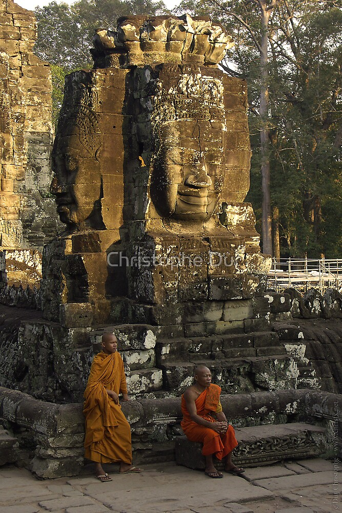 Monks in Bayon Temple - Cambodia by Christophe Dur