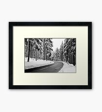 Mountain Road Covered by Snow. Framed Print