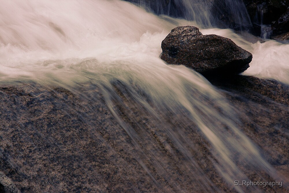 Water over rocks by SLRphotography