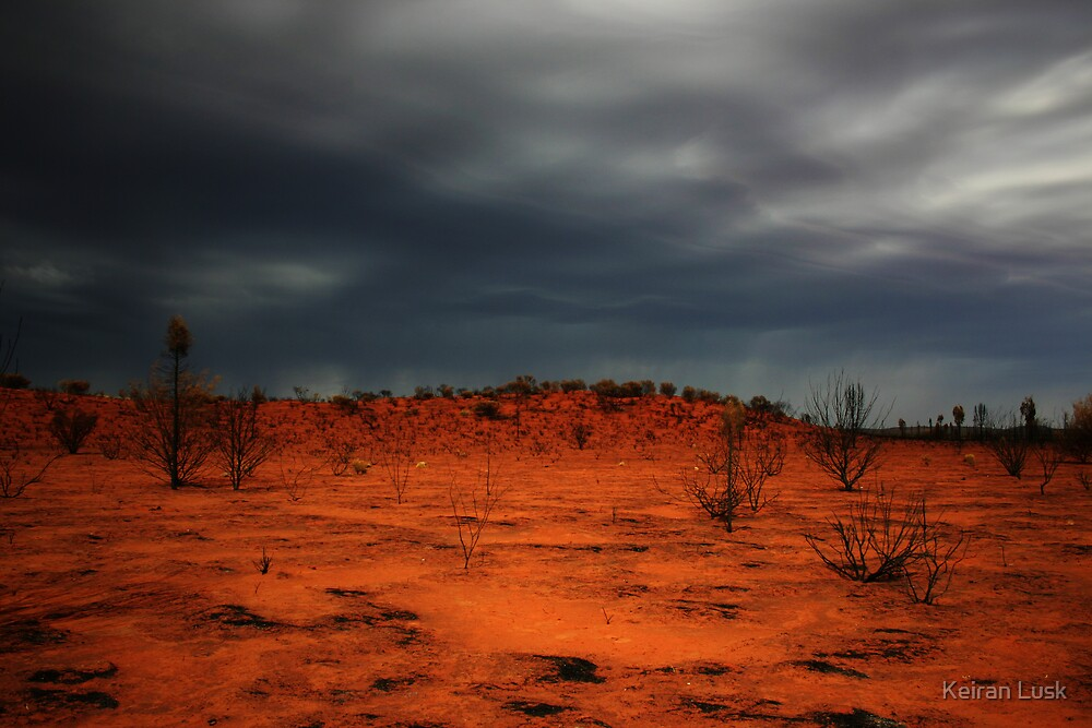 Red dirt.  Black Clouds. by Keiran Lusk