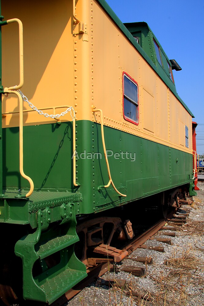 Green and Yellow caboose by Adam Petty