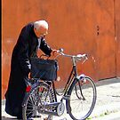 A Priest And His Bicycle. by Margaret Stevens