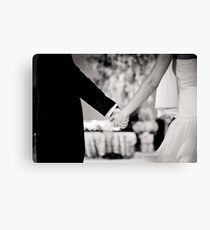 Wedding couple bride groom holding hands back and white photo Canvas Print