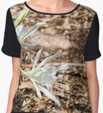 Head of white sand lily flowers in dry grass and lleaves Women's Chiffon Top