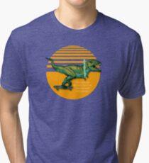 T-Rex on skateboard with a lightsaber  Tri-blend T-Shirt