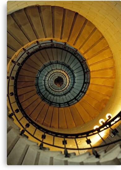 Spiral staircase in lighthouse, looking up, France. by David A. L. Davies