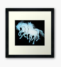 Galloping horses on black Framed Print