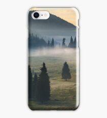 fog on hot sunrise in mountains iPhone Case/Skin