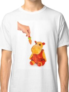 Isolated yellow hippo toy and hand with carrot Classic T-Shirt