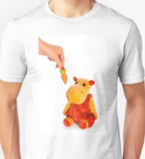Isolated yellow hippo toy and hand with carrot T-Shirt