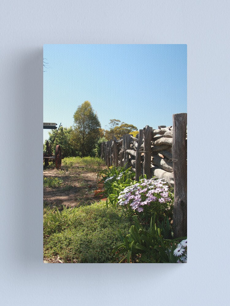 Alternate view of Flowers by the fence Canvas Print