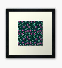 Seamless background of red roses on a green background Framed Print