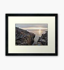 Sunlit rocks in the Baltic sea at sunrise. Framed Print