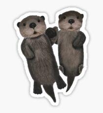 Otters cuddling Sticker