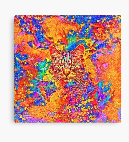 A colorful dramatic Cat is sitting on a colorful quilt Canvas Print