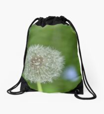 One dandelion growing in the woods Drawstring Bag