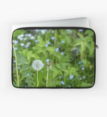 Dandelion growing in the grass Laptop Sleeve