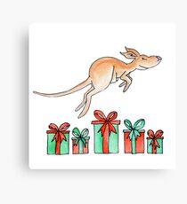 Whimsy kangaroo jumping over Christmas gifts Canvas Print