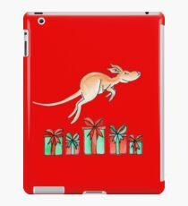 Whimsy kangaroo jumping over Christmas gifts iPad Case/Skin