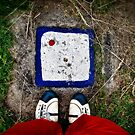 Still life with shoes and white stone by Kurt  Tutschek