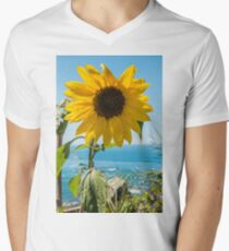Sunflower field. Sunflower with blue sky and the sea in backgorund. Summer background, bright yellow sunflower over blue sky. Landscape with sunflower field over cloudy blue sky. Men's V-Neck T-Shirt