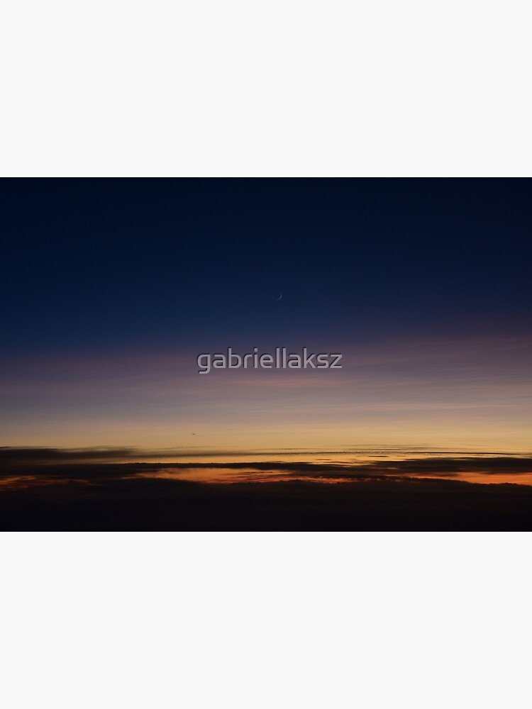 Moon rising above the clouds; sunset above clouds; sunset; moon by gabriellaksz