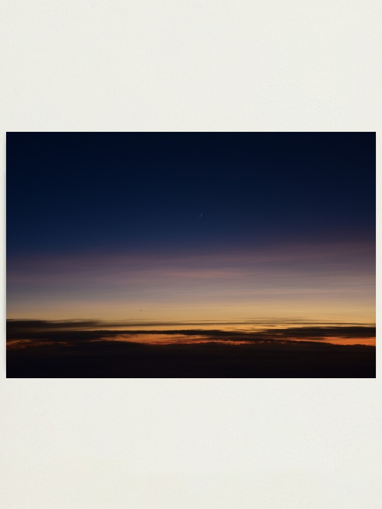 Alternate view of Moon rising above the clouds; sunset above clouds; sunset; moon Photographic Print