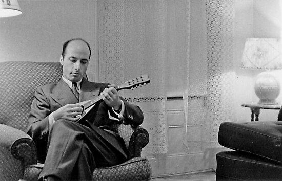 My dad playing mandolin. by Albert