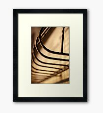 Abstract illuminated pattern of metal rods balconies Framed Print
