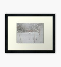 Duck on water in snowstorm Framed Print