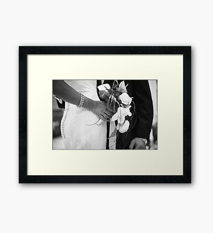 Bride and groom holding black and white wedding photograph Framed Print