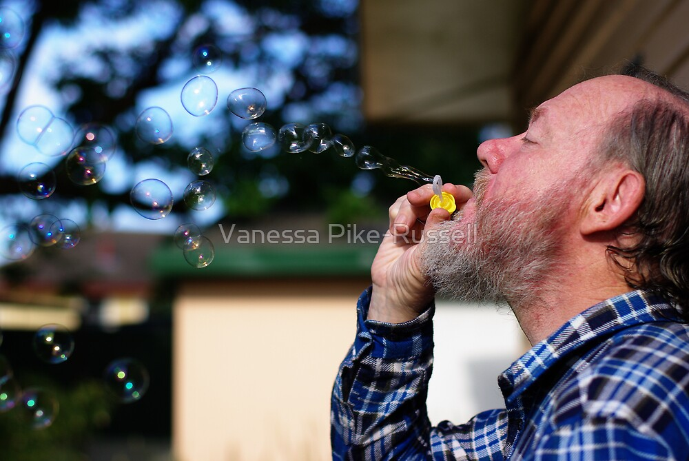 Portrait: Philip blowing bubbles bubbles by Vanessa Pike-Russell
