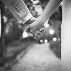Groom holding hands with bride black and white wedding photograph by edwardolive
