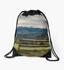 fence on grassy meadow in autumn Drawstring Bag