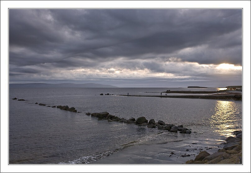 Setting sun over Galway Bay by alanoluain
