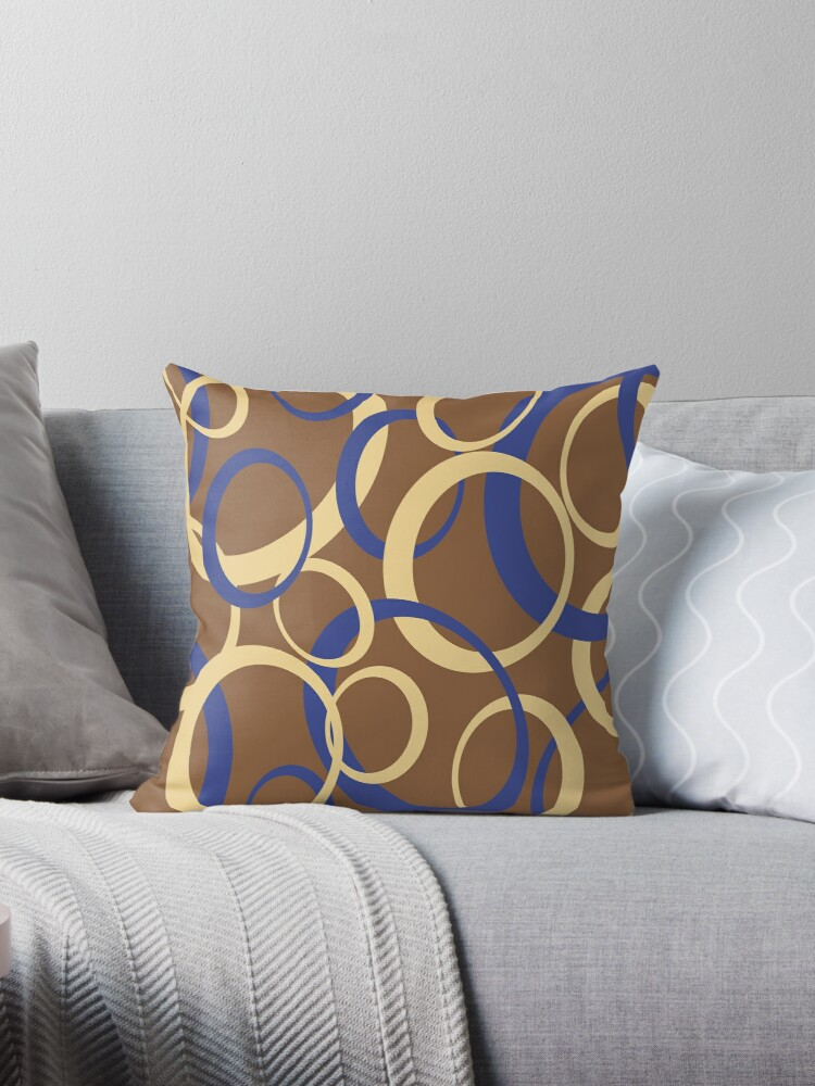 Oval pattern, blue and yellow on a brown background by i3Design