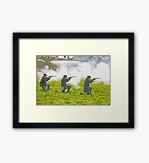 Stylized photo of three Civil War re-enactor soldiers on battlefield firing rifles. Framed Print