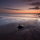 rock in the sand, hackley bay by codaimages